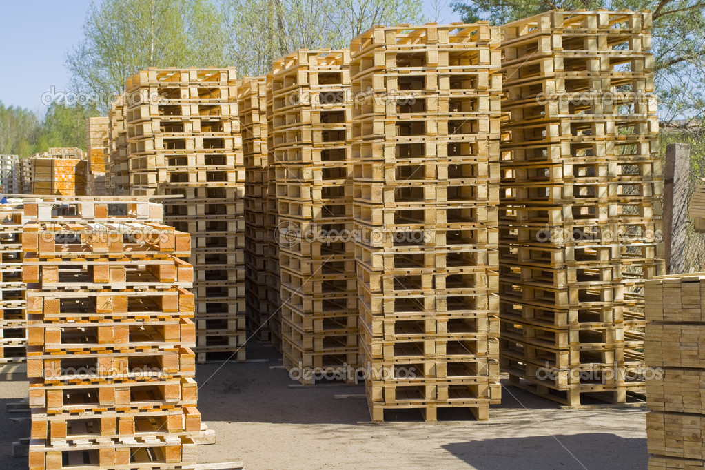 Wooden shipping pallets with sky background