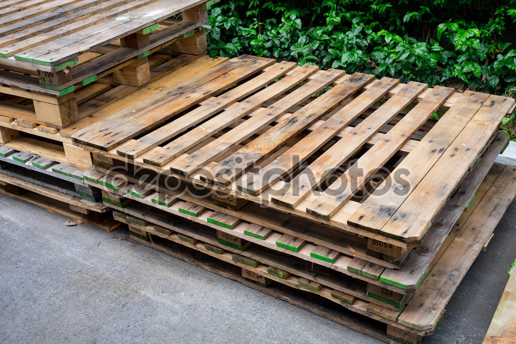 old used pallets stacking together in factory