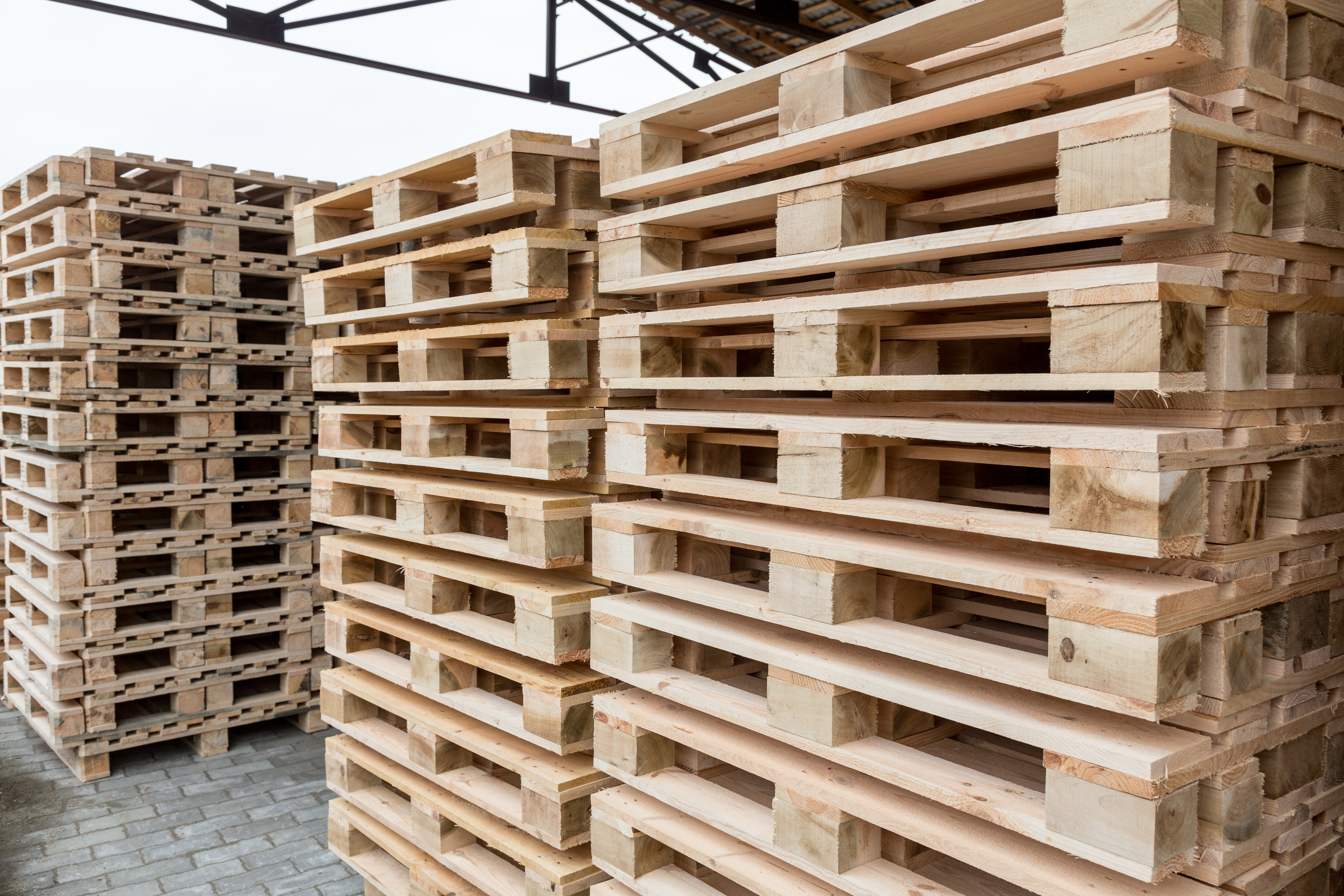 Stock Piles of wooden pallets in a yard